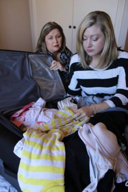 Jenny's Place assistant manager Jill Evans and Melissa Histon-Browning sort through a suitcase of donated clothes.